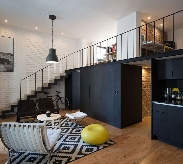 Dark-cabinets-and-kitchen-create-a-striking-visual-in-the-living-room