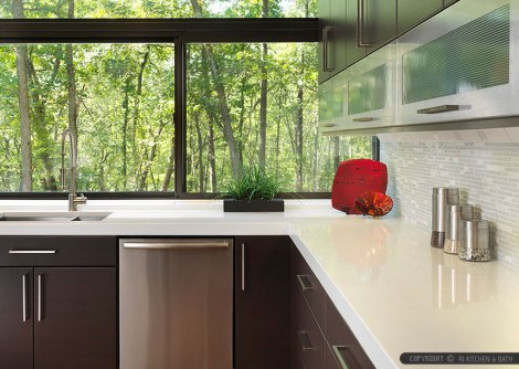 white-countertop-brown-cabinet-marble-glass-backsplash-tile